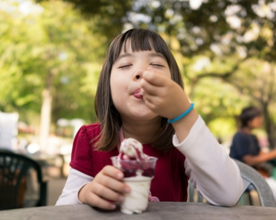 girl eating ice cream happy child
