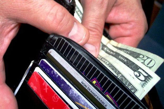hands pull out money from wallet