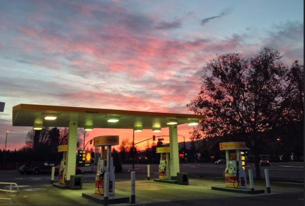 Sunrise at gas station by Don DeBold