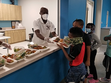 NCCU Athletics, Durham Bulls, Blue Cross NC Team Up to Deliver over 2,000 Meals to Boys & Girls Clubs