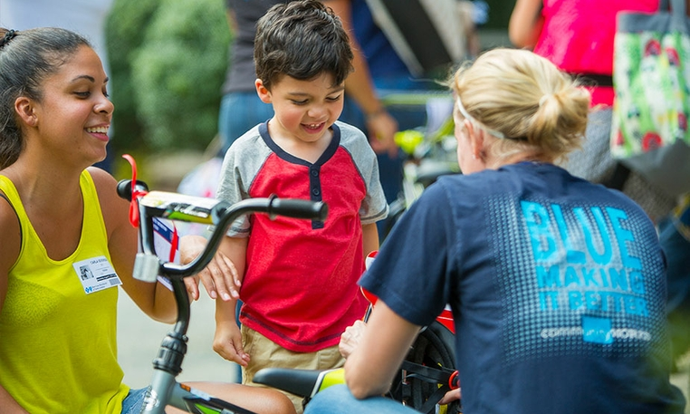 Blue Cross and Blue Shield of North Carolina Partners with USO to Build and Deliver 100 Bikes to Military Children