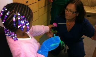 A young patient in Columbus, OH expresses her gratitude to VSP Mobile Eyes manager Kim Rankin