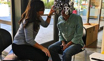 Patient receiving a comprehensive eye exam