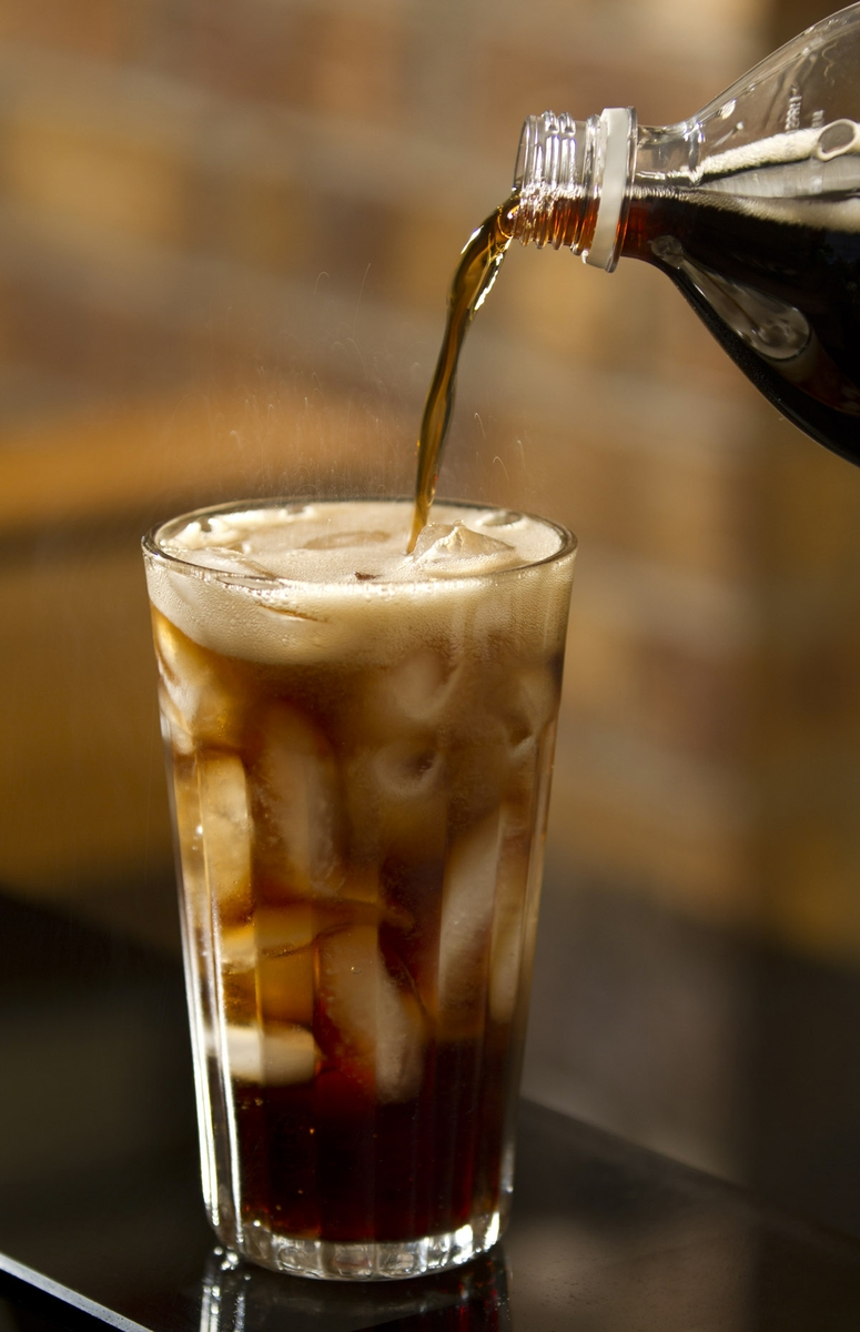Soft Drink - Cola - pouring with bottle