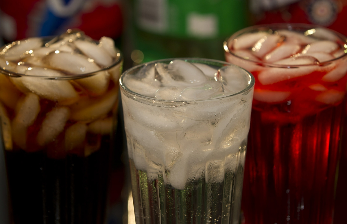 Soft Drinks in Glass with Bottles