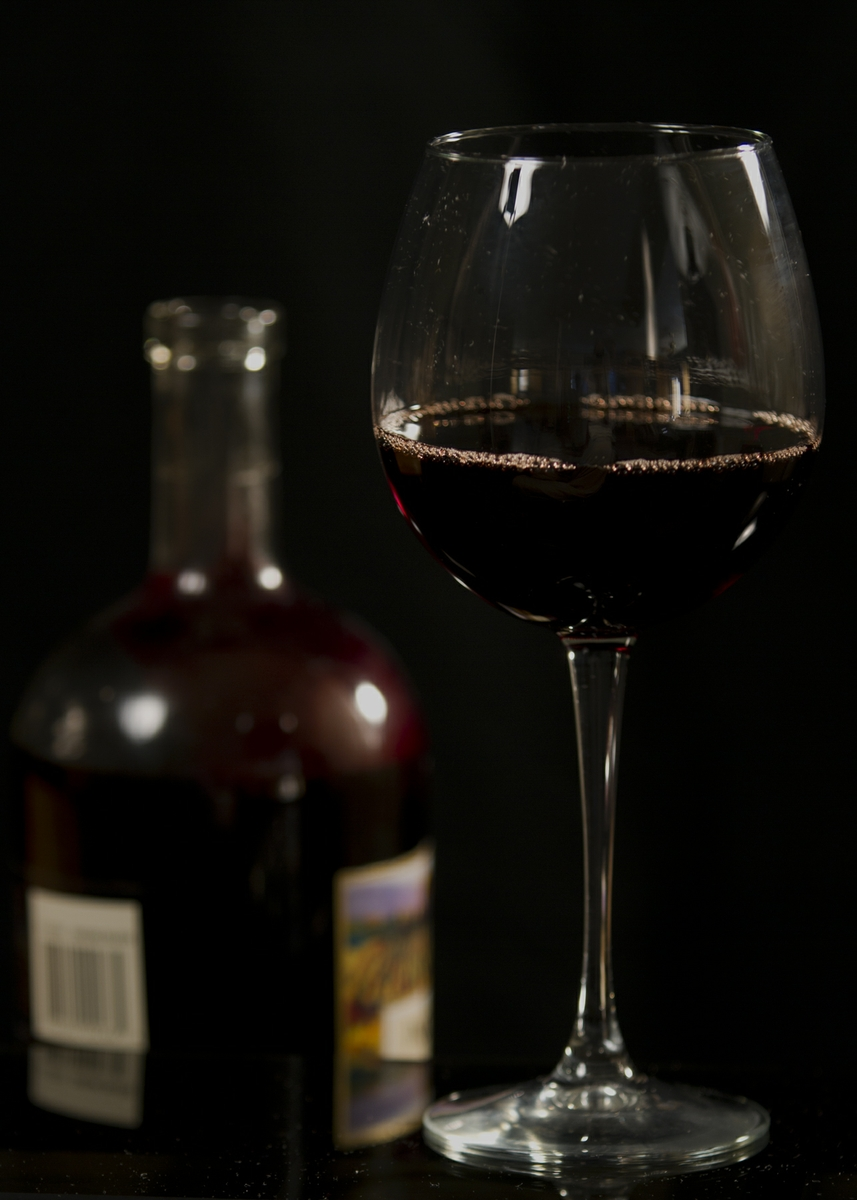 Wine - Red in Glass with bottle straight on