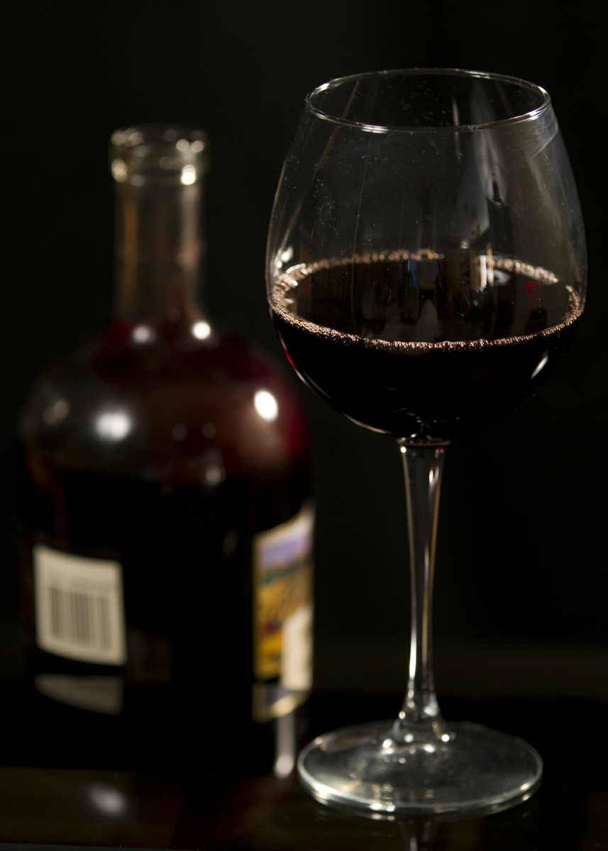 Wine Red in Glass with bottle