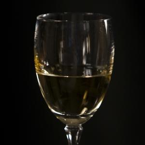 Wine - White in Glass closeup on Glass horizontal