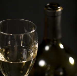 Wine - White in Glass with bottle closeup horizontal