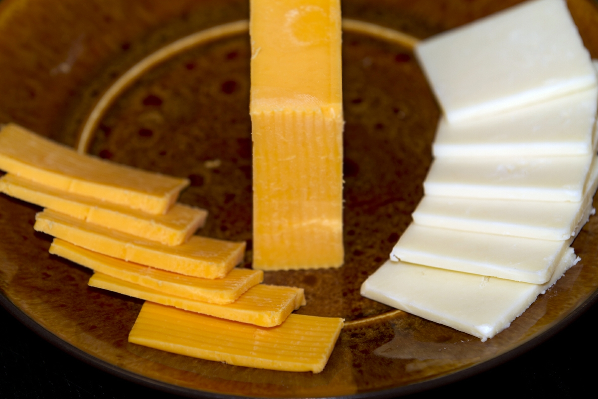 Cheese low-fat cheddar and Colby sliced close up horizontal