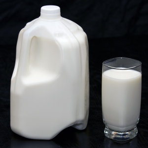 Milk LowFat in glass with full jug horizontal from above