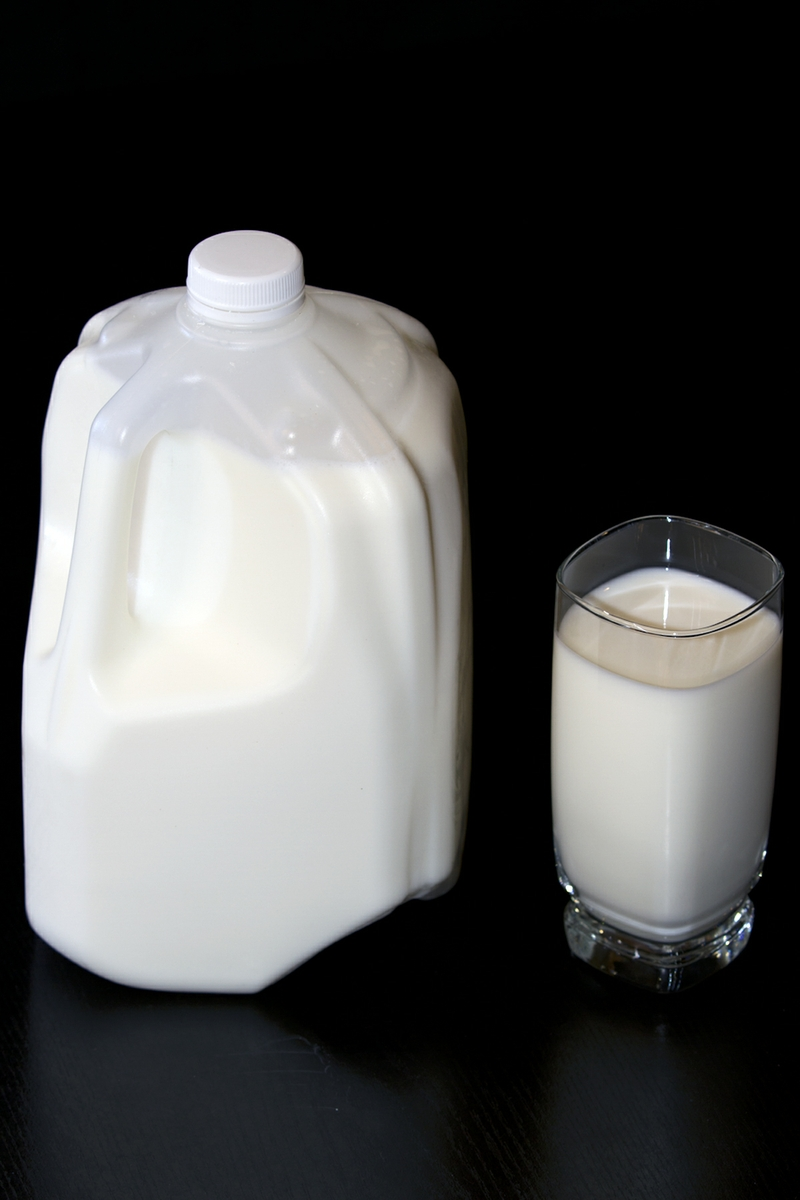 Milk LowFat in glass with full jug verticle from above