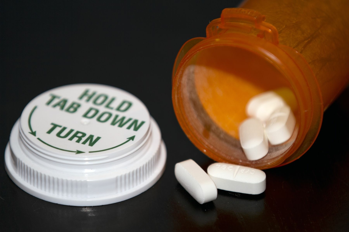Prescription Drug Bottle open with pills close up