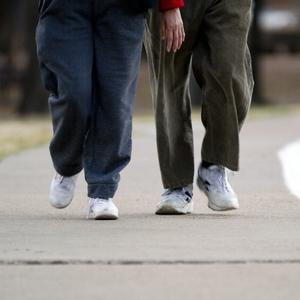 Walking - man and women toward - Outside track
