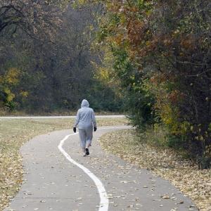 Walking - Woman - wide shot - outside track