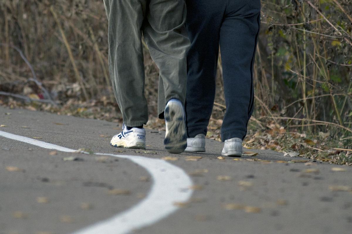Walking - man and women away - Outside track