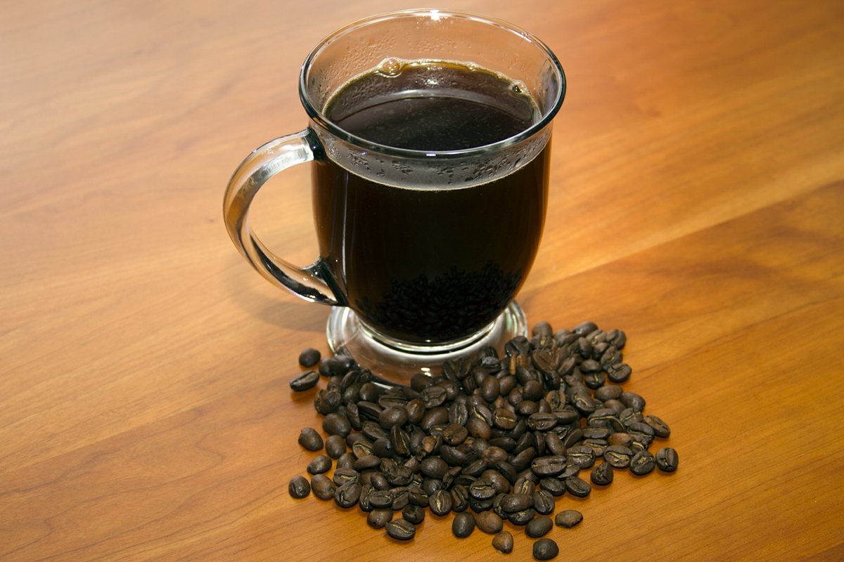 Coffee in Cup with whole beans Horizontal