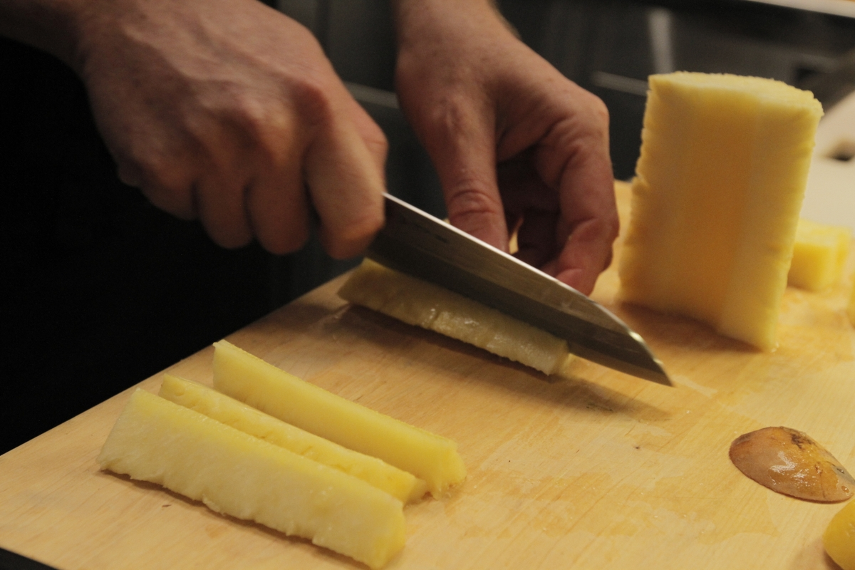 Pineapple being sliced