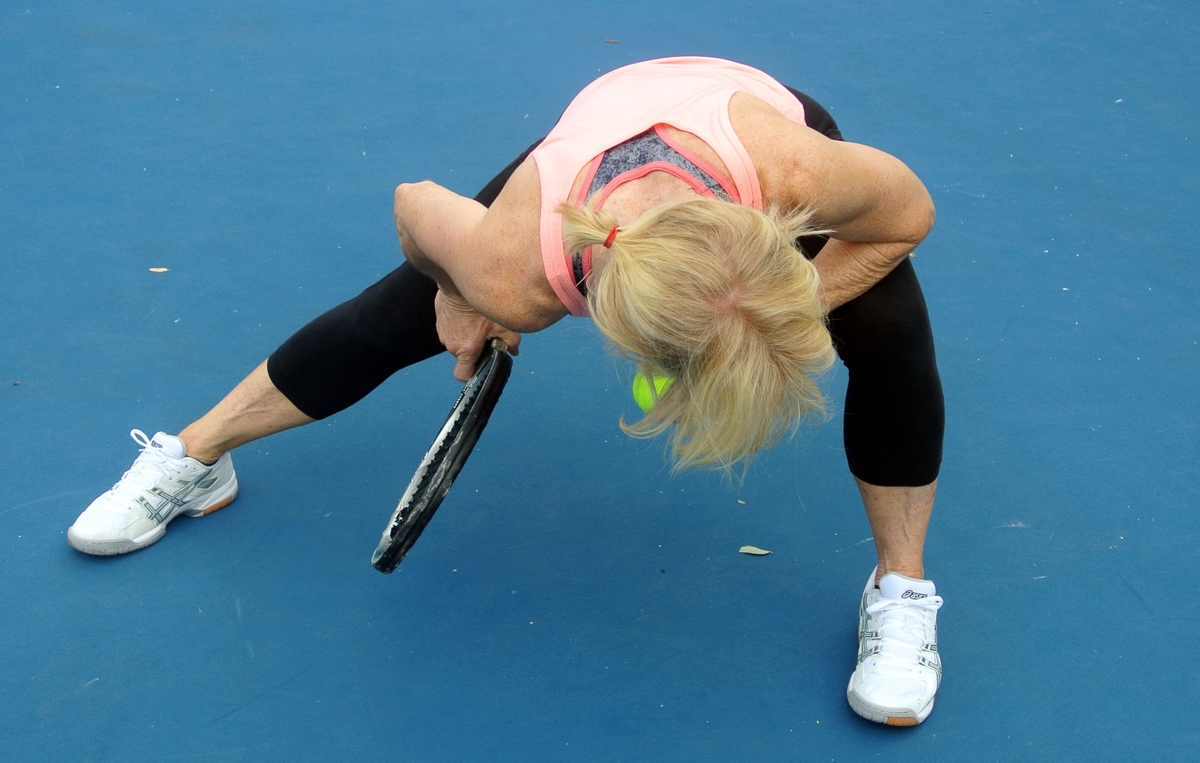 Tennis player stretching muscles