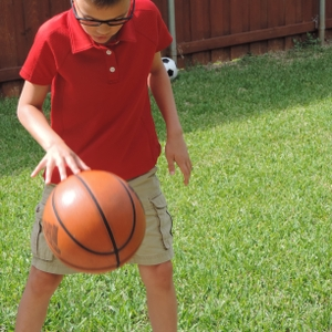 Boy dribbling a basketball