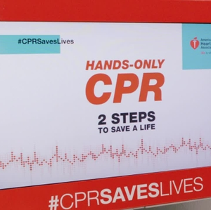 CPR Kiosk - Traveler practicing in airport