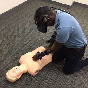 Volunteer performing virtual reality CPR