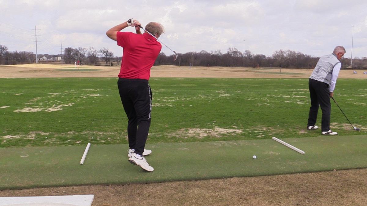 Men practicing golf swing