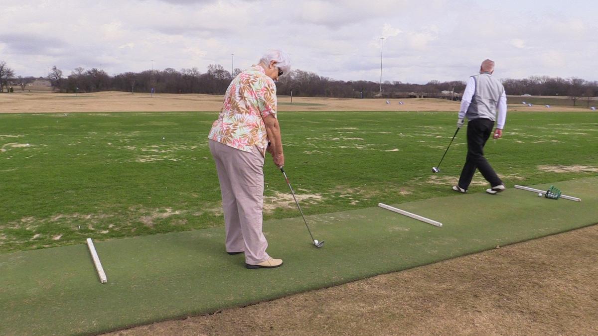 Woman golfing 2