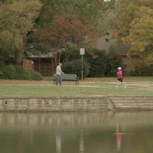 Woman jogging at a park