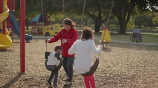 Woman playing with grandchildren at park