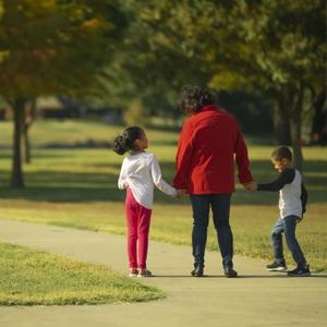 Woman walking with grandchildren
