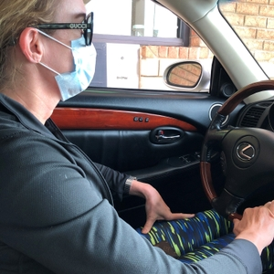 Woman wearing a mask at a drive-thru window