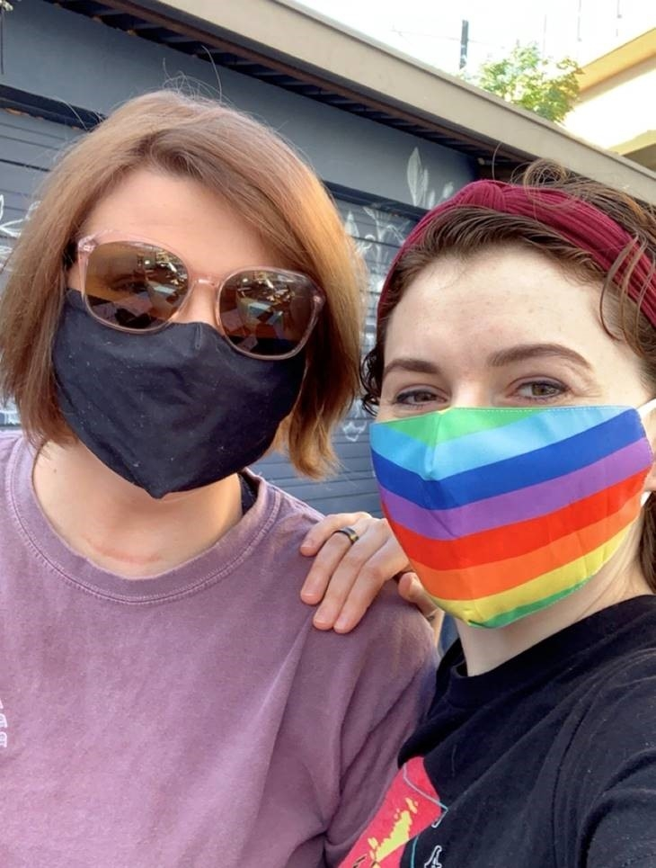 LGBT Couple woman with rainbow mask