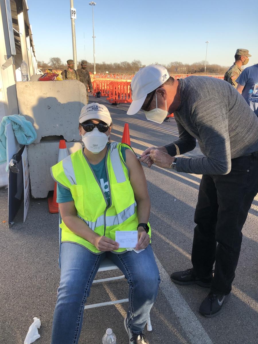COVID-19 vaccine - woman at mega center