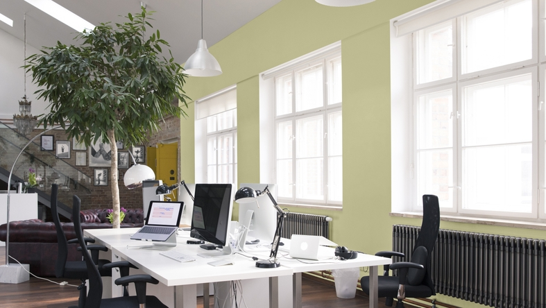 Desks with PCs in bright and modern open space office