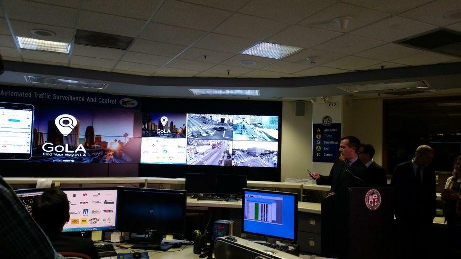 Los Angeles Mayor Eric Garcetti demonstrates the new Xerox Go LA app
