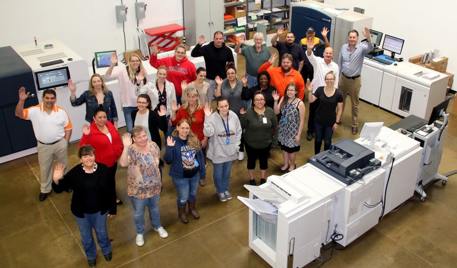 The i3logix team and Xerox presses