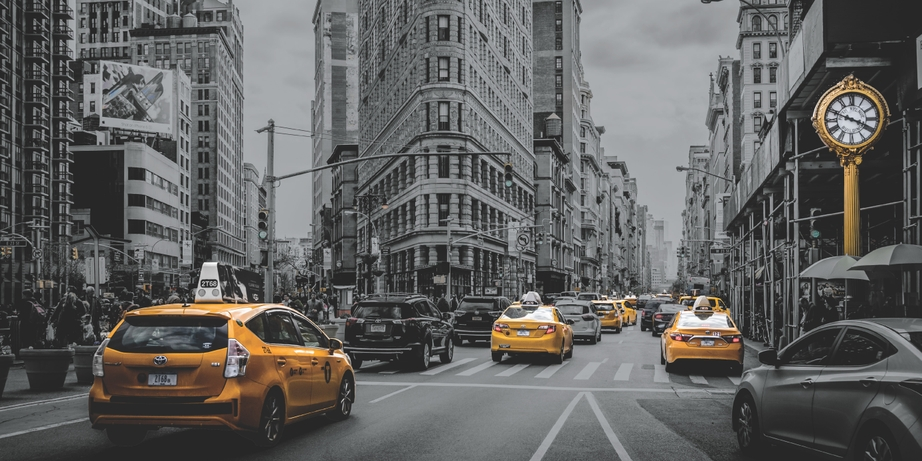 This image by Xerox uses clear dry ink to make the yellow on the taxis stand out.