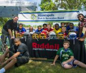 Minneapolis Park and Recreation Board Youth Football Players Celebrate Larry Fitzgerald, Jr. and Riddell's Donation of New Helmets for Youth Football Program