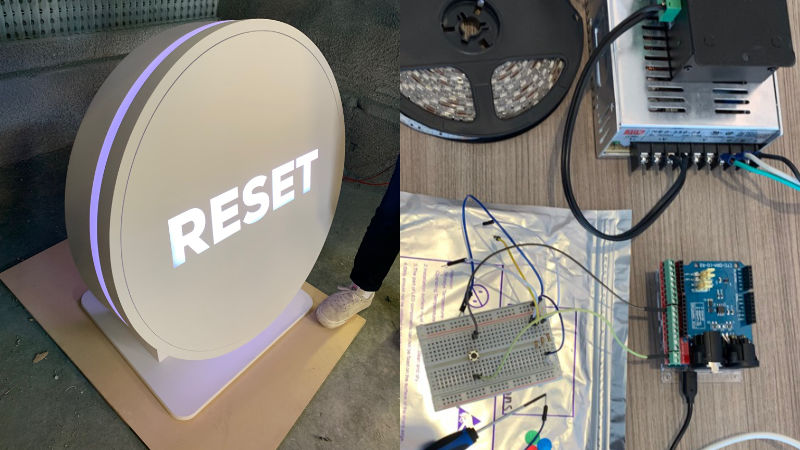 Giant novelty button with the word 'reset' displayed, electronics