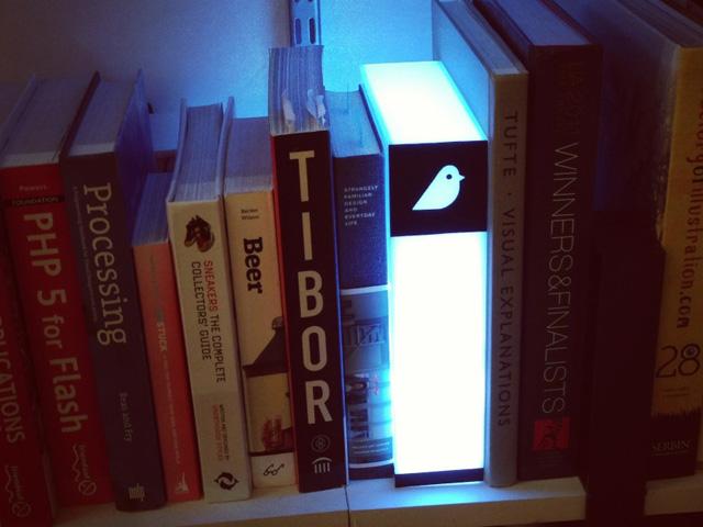 illuminated glowing book on shelf