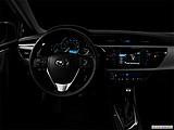 2015 Toyota Corolla 4dr Sedan CVT LE Plus - Centered wide dash shot - 'night' shot