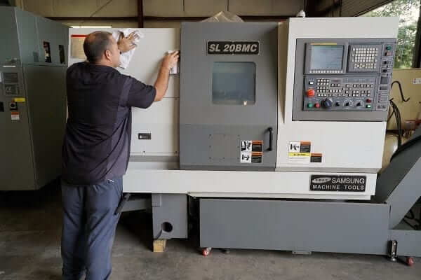 Cleaning Samsung CNC Machine