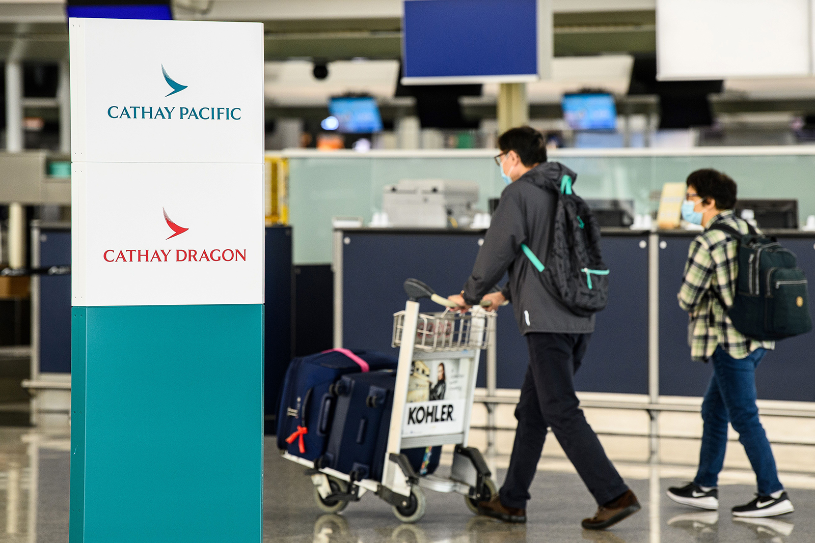 Cathay Pacific to cut thousands of jobs and eliminate Cathay Dragon airline as Covid-19 weighs on travel