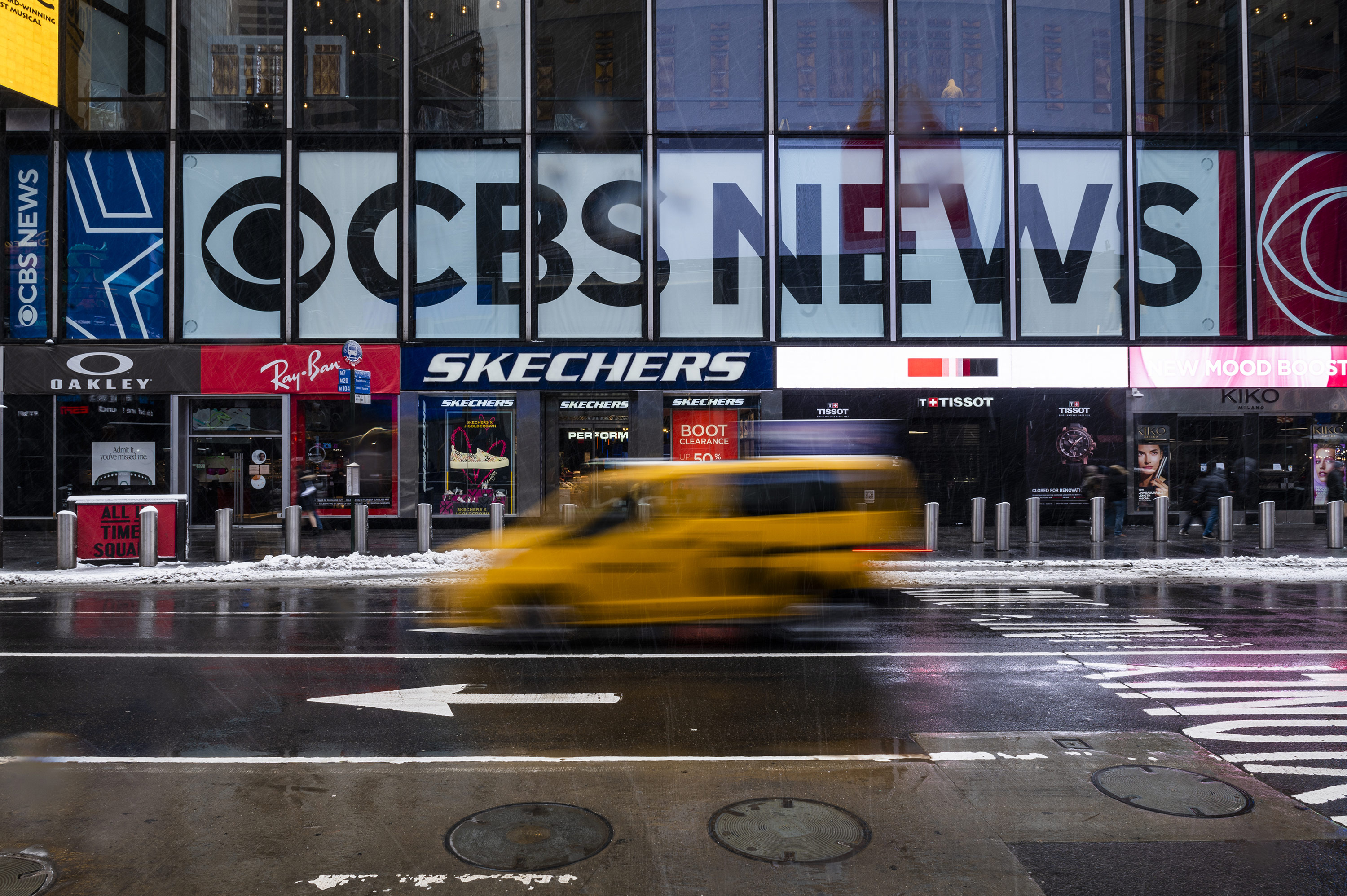 CBS names two executives to run a newly-combined news division and local TV stations