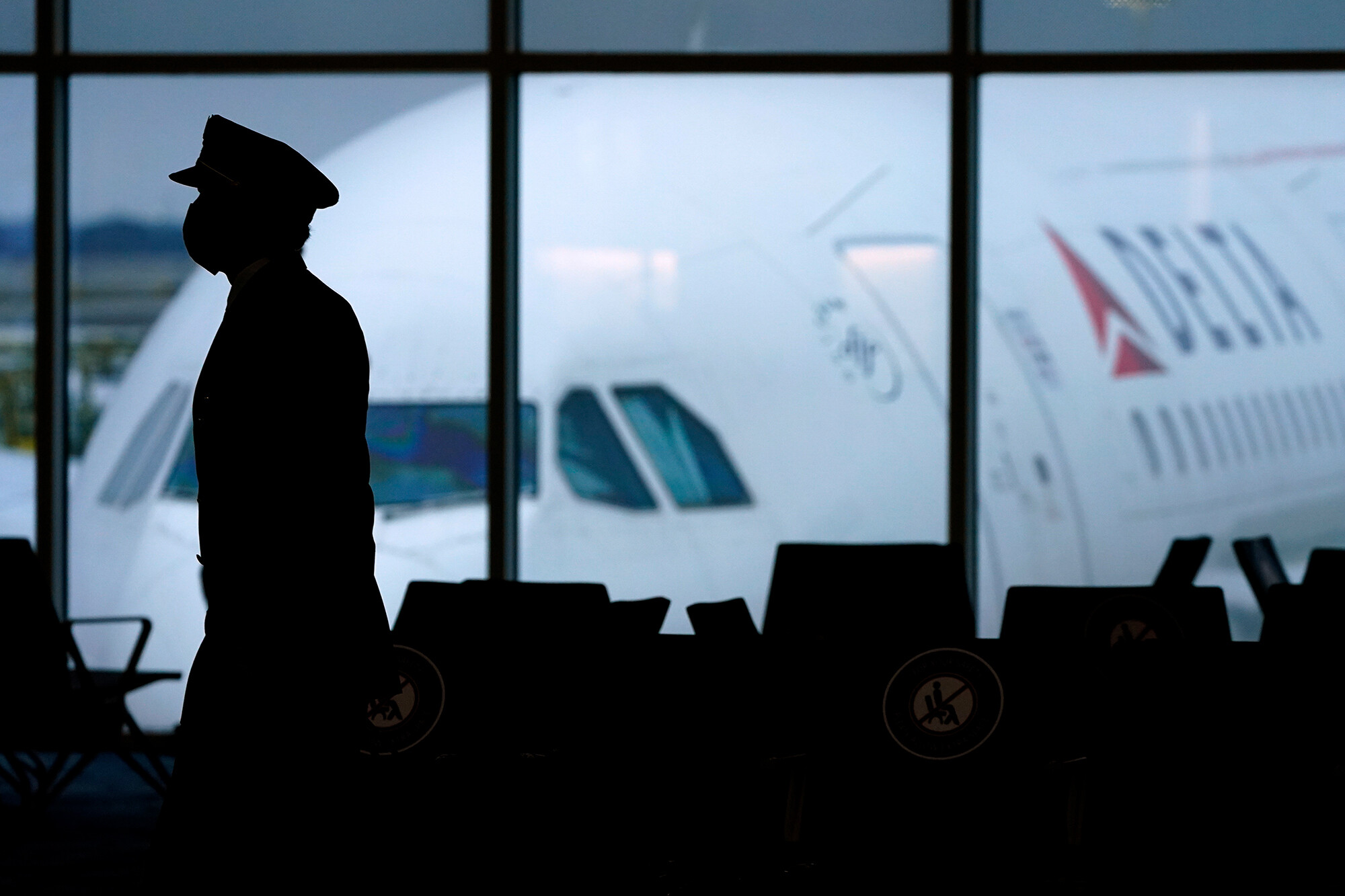 Delta will hike insurance premiums and limit sick pay for unvaccinated employees