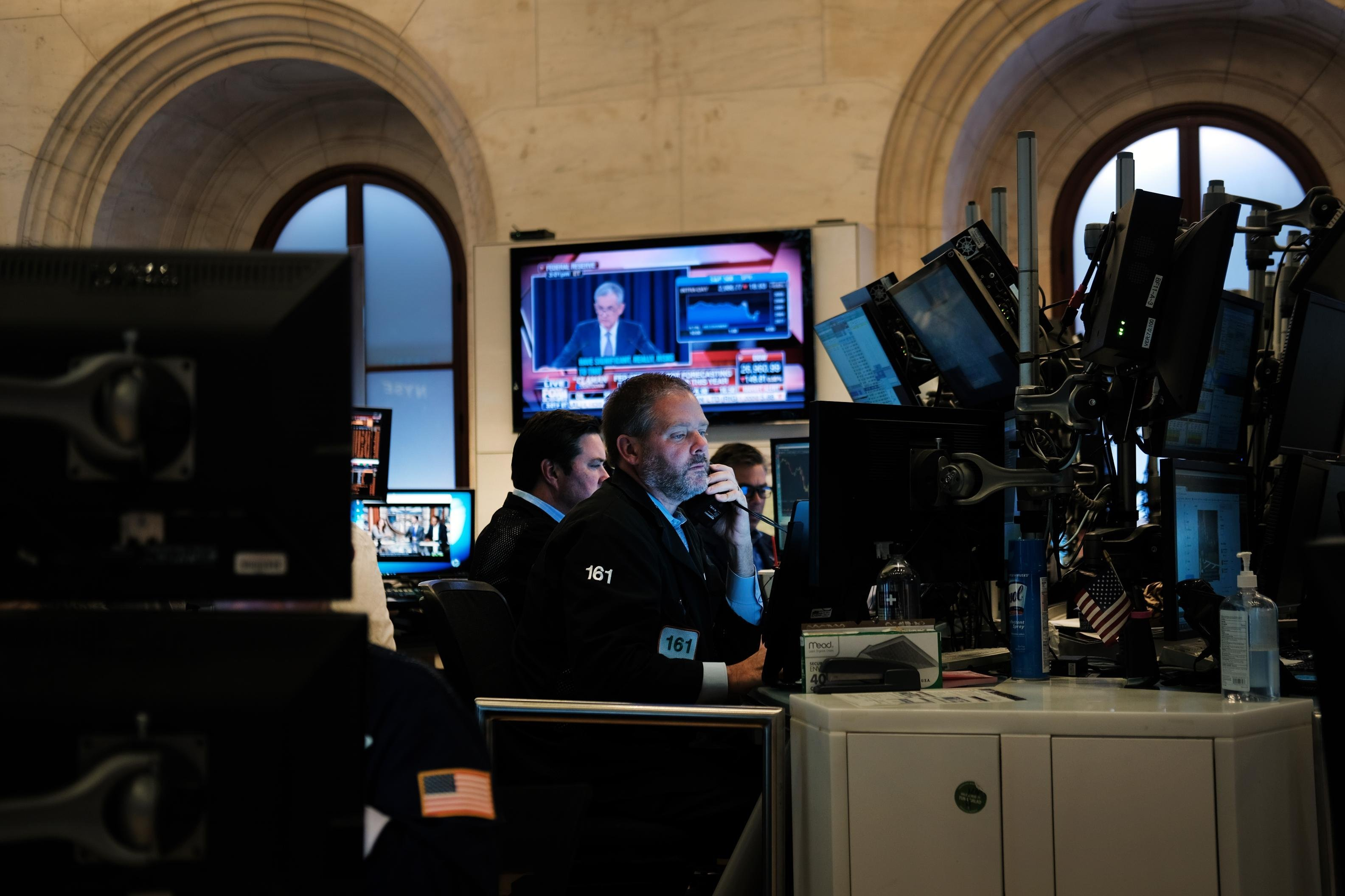 Dow closes slightly lower after Fed's interest rate decision