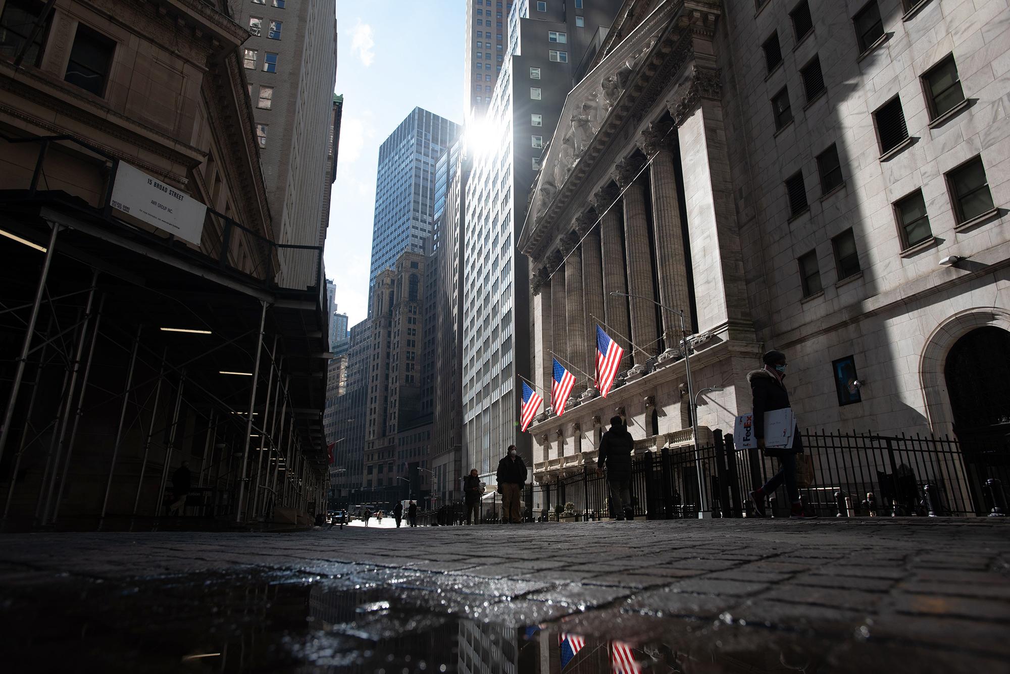 Dow slides more than 550 points as bond yields climb