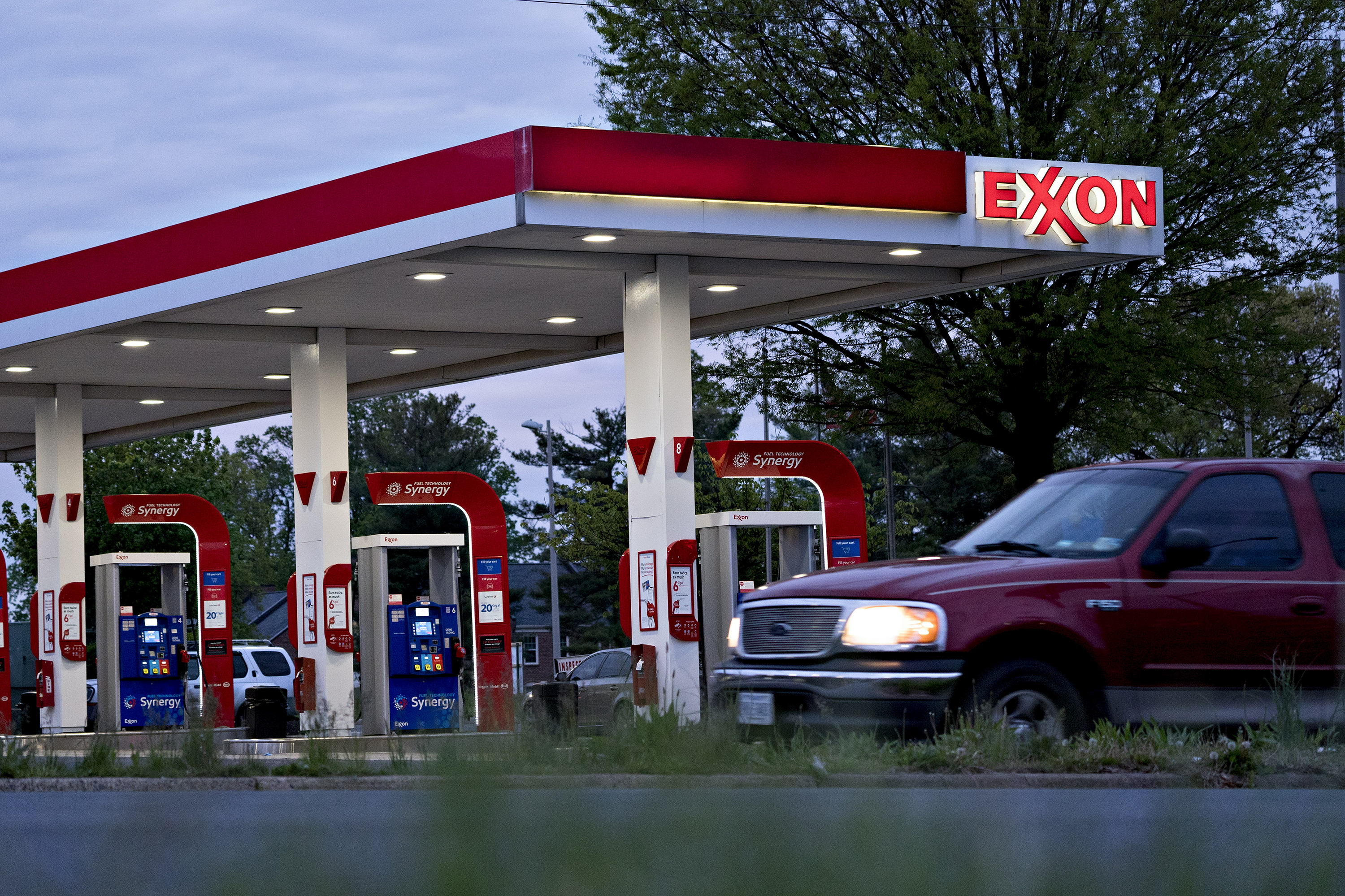 Chevron and Exxon post huge losses as oil prices plummet