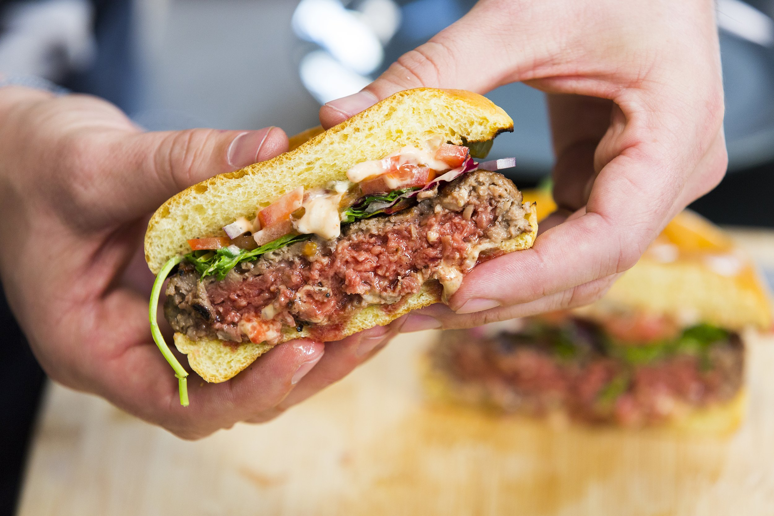 Impossible Burgers will start selling in grocery stores for the first time this week
